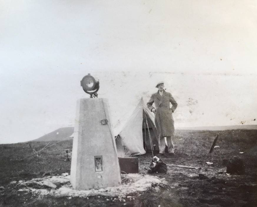 The type of beacons used and the surveyor's tent for protection through the night