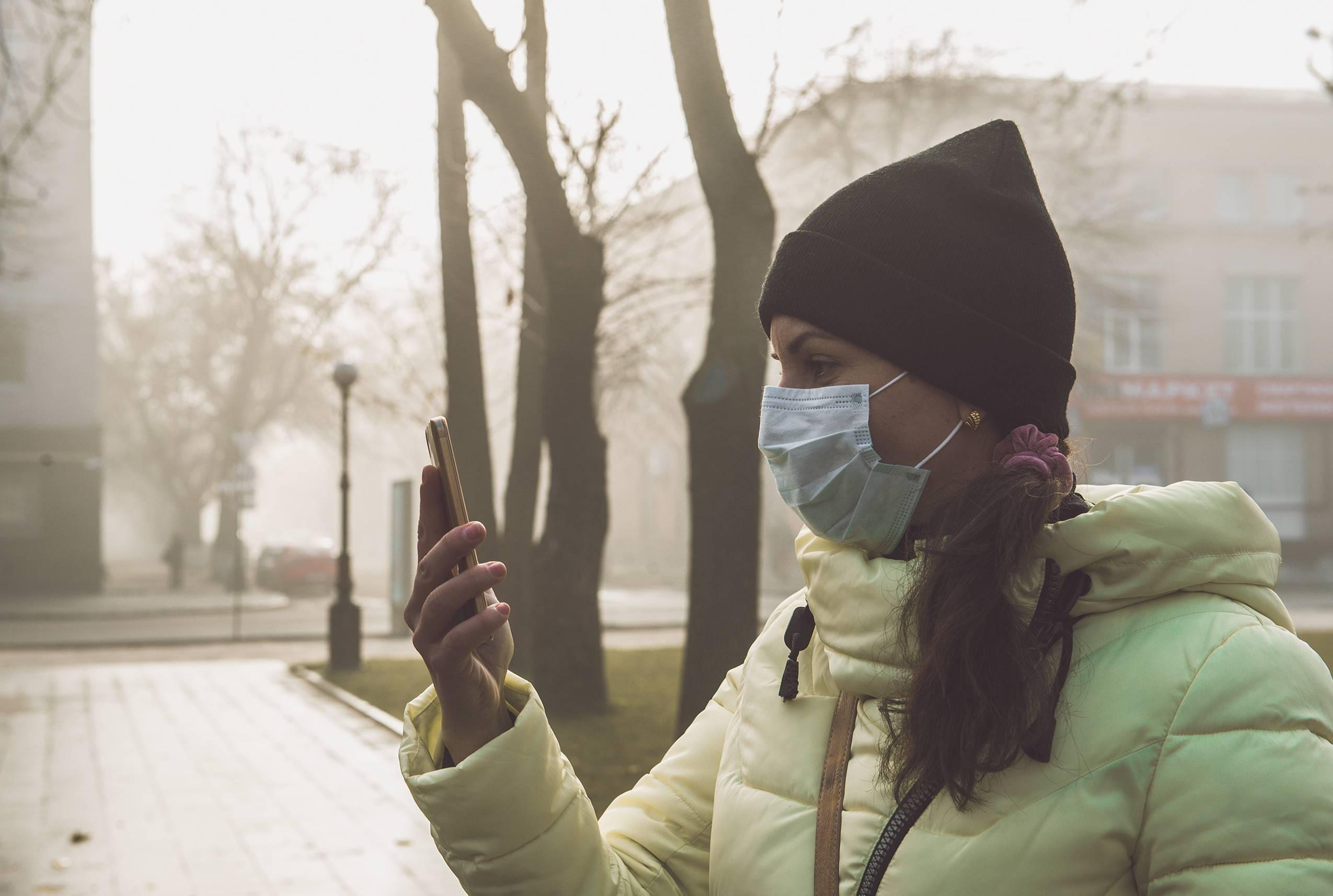 Woman with a face mask in smog